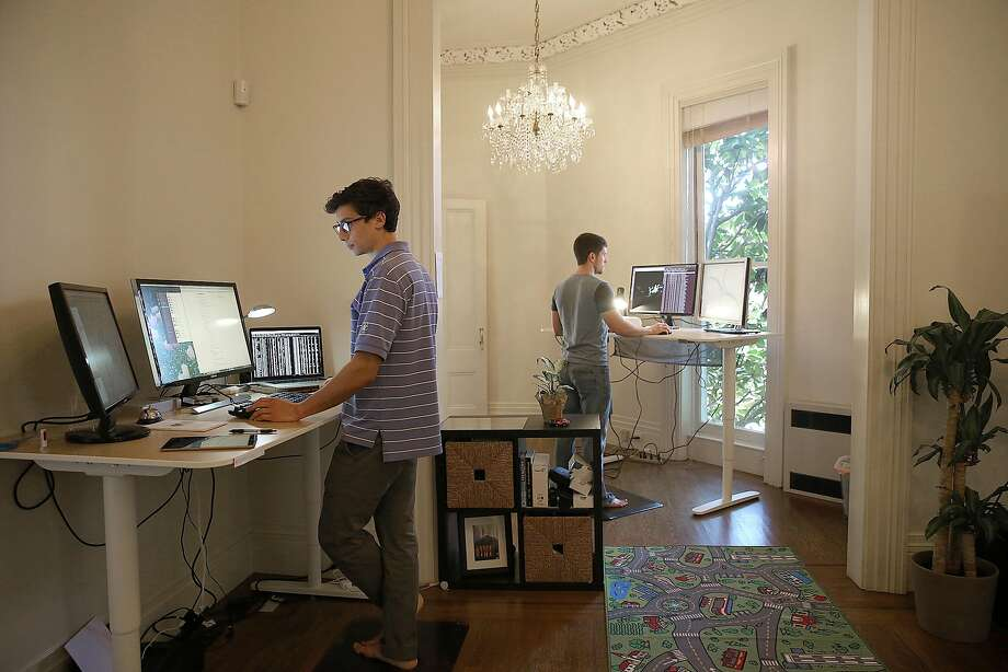 Lvl5 founder and CEO Andrew Kouri (left) and Erik Reed, chief product officer, work at the self-driving tech company's headquarters at the Feusier Octagon house in San Francisco on Monday. Photo: Liz Hafalia, The Chronicle