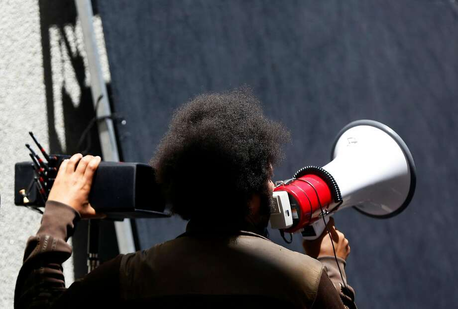 "Director Boots Riley addresses actors and extras on the set of his film  ""Sorry to Bother You"" between takes July 14, 2017 in downtown Oakland, Calif. Photo: Leah Millis, The Chronicle"