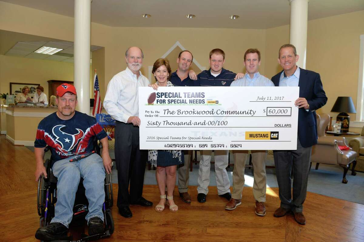 Special Teams for Special Needs, a collaboration between the Houston Texans and Mustang Cat, presented the Brookwood Community with a donation of $60,000 on July 11, 2017. From left are: Jeff Lawler of the Brookwood Community, Brad Tucker, president of Mustang Cat; Stephanie, Sam, Frank and Ben Tucker; Jamey Rootes, president, Houston Texans.