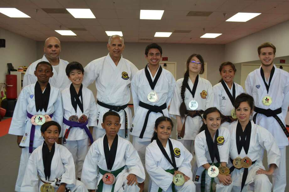 Eight Fort Bend ISD students helped form a 16-member athletic team that competed at the 2017 Texas National State Karate Championship and Qualifier in May, with individual members placing in the top three positions of their divisions. From left, first row, are:Tyler Lopez, Jayden Goodman, Nalika Nana, Christina Korman, Sensei Cassie Pham-Korman; back row: James Goodman, Jr., Sensei Nizar Albagdadi, Kaito Sengoku, Sensei Ramon Veras, Rylan Garza, Elaina Lan, Charlize Lopez and Sensei Andres Sanabria. Photo: Fort Bend ISD