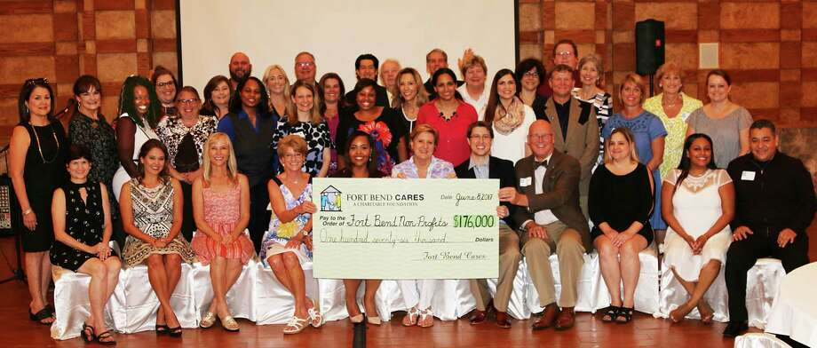 Shown here are representatives from Fort Bend Cares 2017 grant recipients and Fort Bend Cares Board of Trustees. Photo: Mary Favre / MARY FAVRE