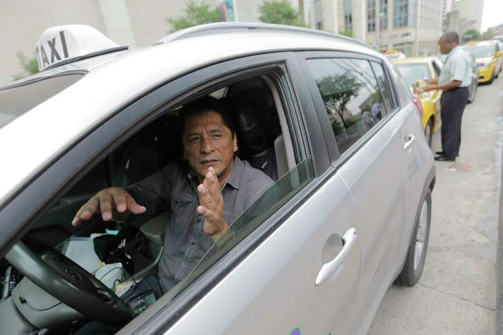 José Fong waits in his cab on Milan Street next to the Chase building downtown on Tuesday, July 18, 2017, in Houston.