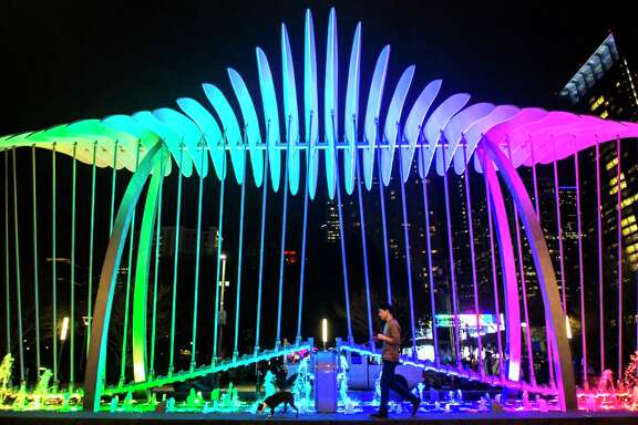 Vince Dancer walks his dog Gemma in front of the Wings over Water kinetic sculpture on the Avenida Houston, the new civic plaza in front of the George R. Brown Convention Center, Wednesday, Jan. 25, 2017 in Houston. ( Michael Ciaglo / Houston Chronicle )