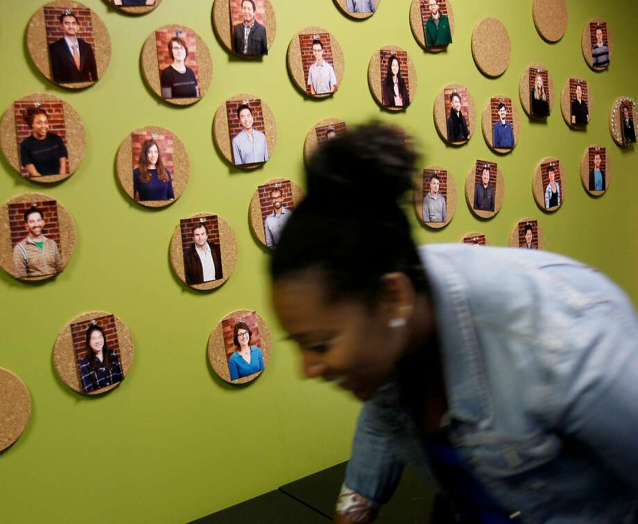 A student hurries past a display of students at Dev Bootcamp in S.F. in 2014. Photo: Brant Ward, The Chronicle