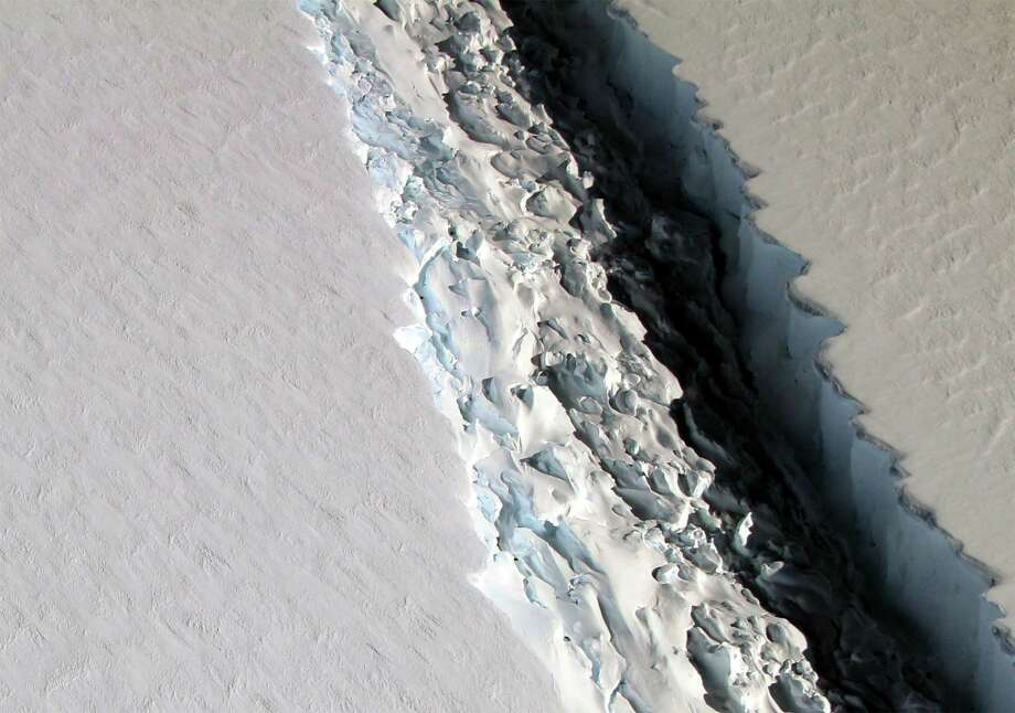 After months of dangling on by a miles-thin thread of ice, an iceberg roughly the size of Delaware just calved off Antarctica's Larsen C ice shelf and began drifting out into the ocean. This is the kind of reality that a new report says such coastal states as Texas ignore at their peril. Flooding to come. Photo: NASA /TNS / Zuma Press