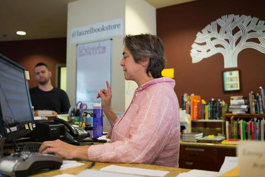 Laurel Book Store owner Luan Stauss organizes orders in the store in downtown Oakland. Stauss is struggling to keep the store open after moving to its new location. Photo: James Tensuan, Special To The Chronicle