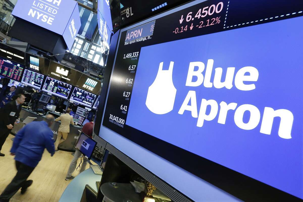 The Blue Apron logo appears above a trading post on the floor of the New York Stock Exchange, Tuesday, July 18, 2017. The meal kit company tumbled after The Sunday Times reported that Amazon is getting ready to launch its own meal-prep business. (AP Photo/Richard Drew)