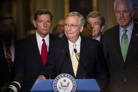 Senate Majority Leader Mitch McConnell, a Republican from Kentucky, center, listens to a question during a news conference after a weekly GOP luncheon meeting at the U.S. Capitol in Washington, D.C., U.S., on Tuesday, July 18, 2017. McConnell's new proposal to simply repeal Obamacare appears to be dead less than 24 hours after he dropped his replacement plan for lack of support among fellow Republicans. Photographer: Zach Gibson/Bloomberg