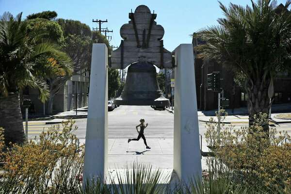 Hilary Dykes trains for a marathon at Dolores Park on Friday, July 7, 2017, in San Francisco, Calif. She is to participate in the S.F. Marathon and attempt to qualify for the Boston Marathon.