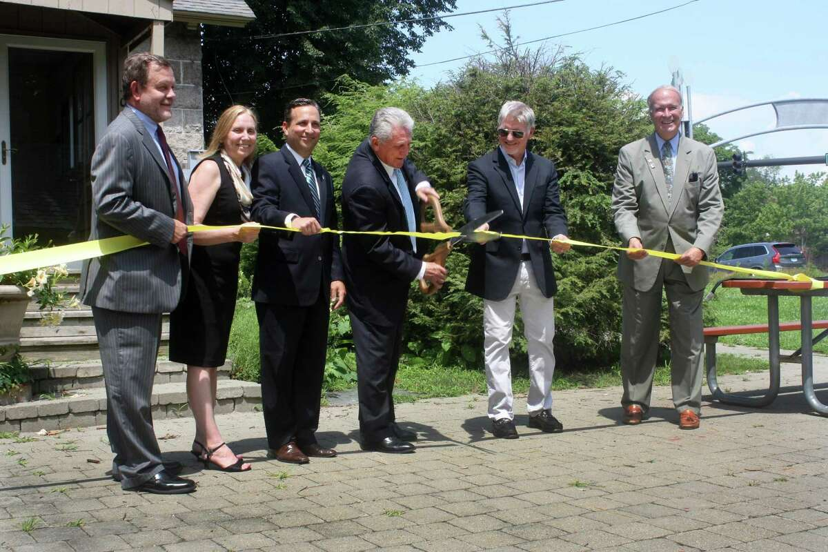 Andrew Norton, Diane Weaver Dunne, State Sen. Bob Duff, D-Norwalk, Norwalk Mayor Harry Rilling, David Westmoreland, and Paul A. Young at a ribbon cutting ceremony at CRIS Radio's Norwalk Studio at Gate Lodge in Mathews Park on Monday.