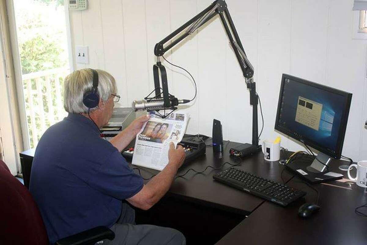 Scott Baecker, operations director for the CRIS Radio Norwalk Regional Studio, in the Gate Lodge at Mathews Park in Norwalk.