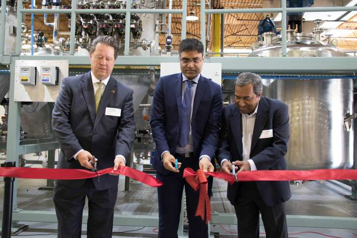 From left, Jeff Wiley, President and Chief Executive Officer of the Fort Bend Economic Development Council; Mahesh Patel, Chief Executive Officer of ShayoNano; and Cyriac Alexander of the Alexander Technical Institute cut the ribbon in late May on a new ShayoNano production facility.