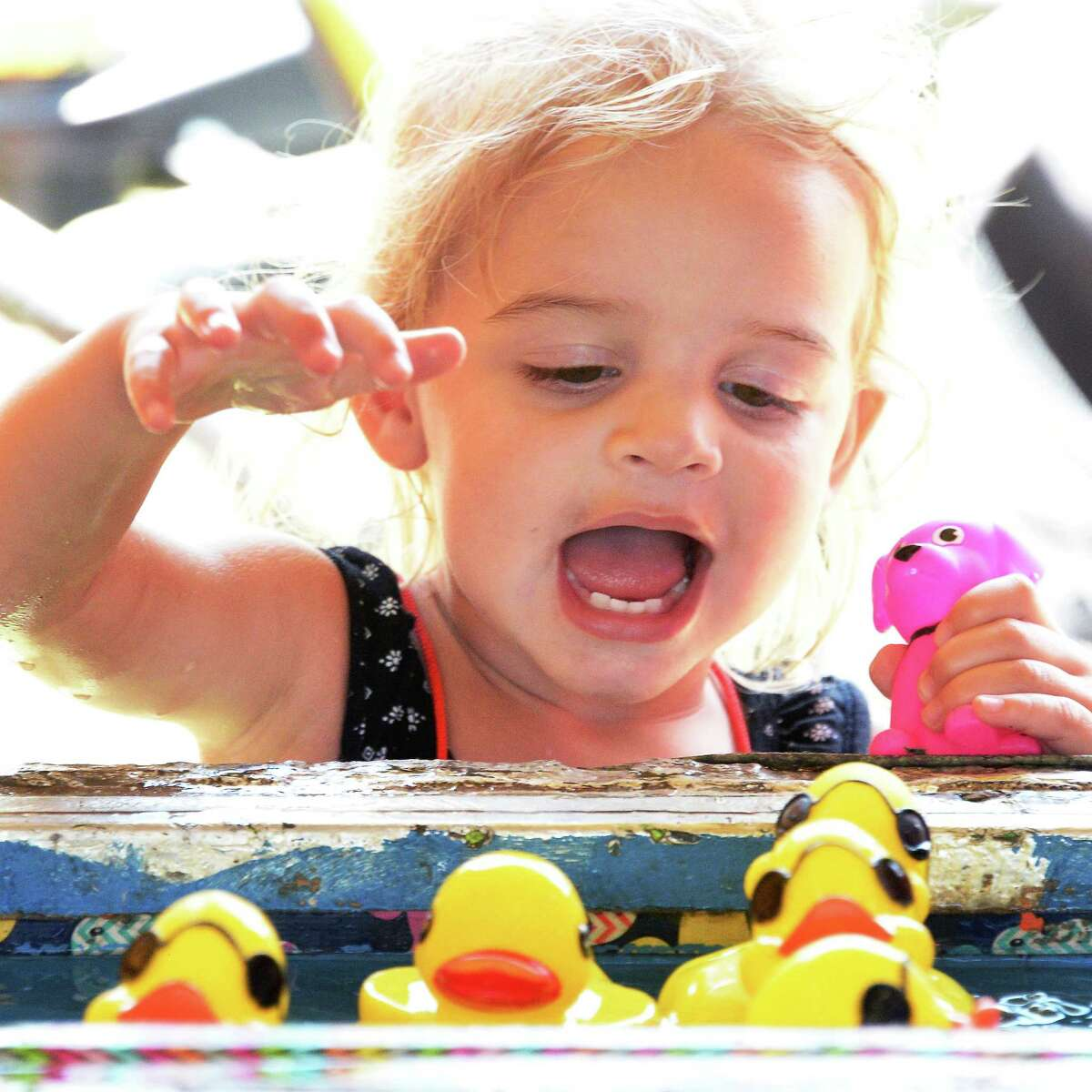 Two-year-old Sasha Bahadori of St. George, Kansas keeps cool at the Duck Pond game at the Saratoga County Fair Tuesday July 18, 2017 in Ballston Spa, NY. (John Carl D'Annibale / Times Union)