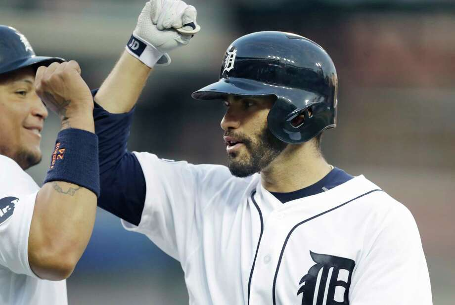 Detroit Tigers' J.D. Martinez, right, is congratulated by Miguel Cabrera after they and Justin Upton scored on Martinez's three-run home run during the eighth inning against the Toronto Blue Jays in a baseball game Saturday, July 15, 2017, in Detroit. Photo: Carlos Osorio, AP / Copyright 2017 The Associated Press. All rights reserved.