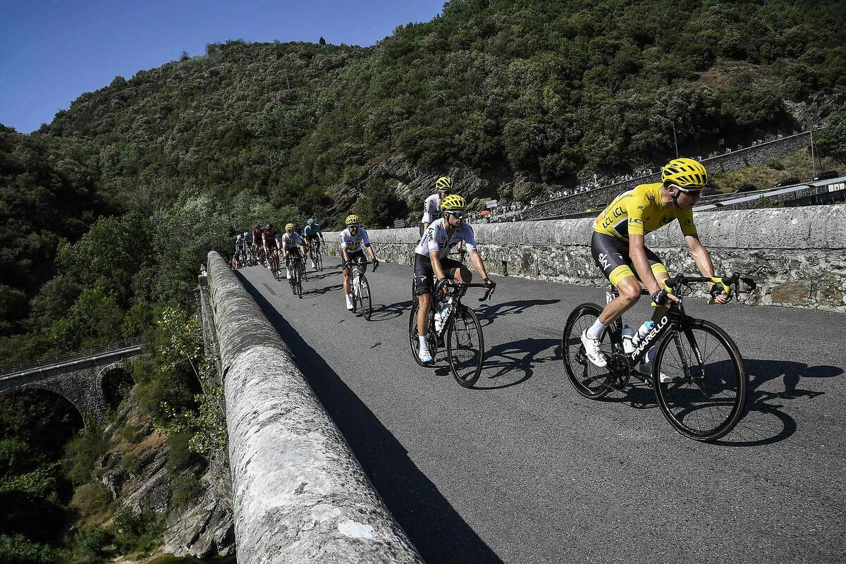 Great Britain's Christopher Froome (R), wearing the overall leader's yellow jersey, rides on a bridge ahead of his teammate Spain's Mikel Landa (2ndR) during the 165 km sixteenth stage of the 104th edition of the Tour de France cycling race on July 18, 2017 between Le Puy-en-Velay and Romans-sur-Isere. / AFP PHOTO / Lionel BONAVENTURELIONEL BONAVENTURE/AFP/Getty Images