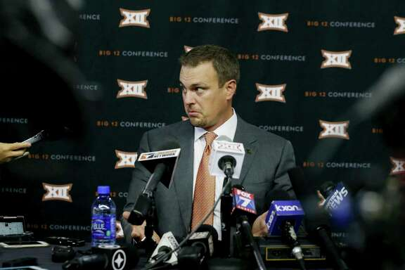 Texas head football coach Tom Herman listens to a reporter's question during the Big 12 NCAA college football media day in Frisco, Texas, Tuesday, July 18, 2017. (AP Photo/LM Otero)