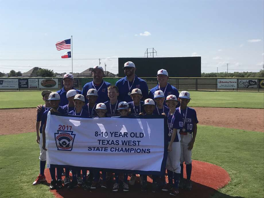 Players and coaches of Midland Northern's Little League 8-10 year-old All-Star team pose with the Texas West state championship banner, Tuesday at Kirby Park in Abilene. Courtesy photo.