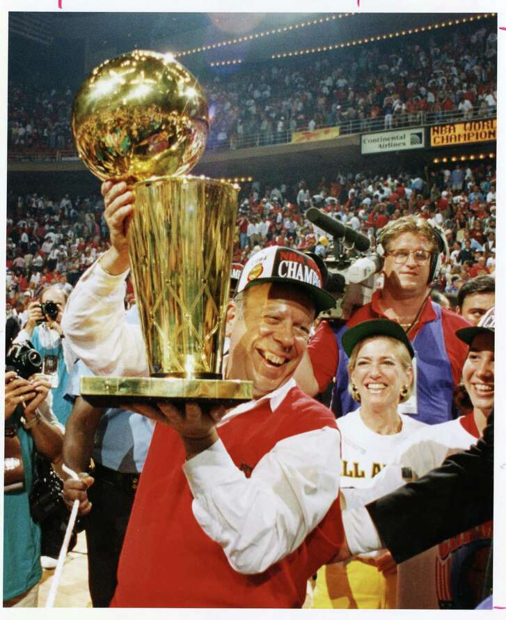 Owner Leslie Alexander clutches the trophy after the Rockets beat the Knicks in 1994 for the NBA title. (Houston Chronicle file)