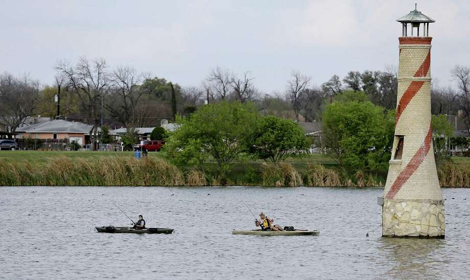Fishermen try their luck at Woodlawn Lake Park. Photo: Staff File Photo / © 2016 San Antonio Express-News