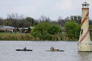 Fishermen try their luck at Woodlawn Lake Park.