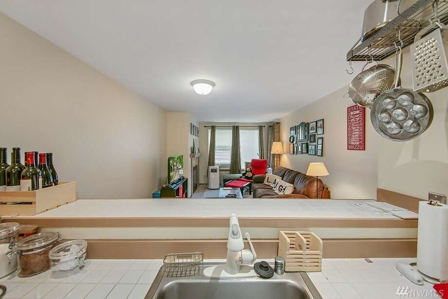Close to shopping, restaurants, and transit, this cute one-bedroom has an open floor plan and a private balcony. The unit comes with a stack washer and dryer, as well as garage parking and storage — not to mention updates in 2012 to the siding, windows, plumbing, deck surfaces and railings.It's located at 2152 N. 112th St. #215, listed at $220,000. See the full listing here. Photo: Listing Provided Courtesy Of Michael Bill, Windermere Real Estate Co.