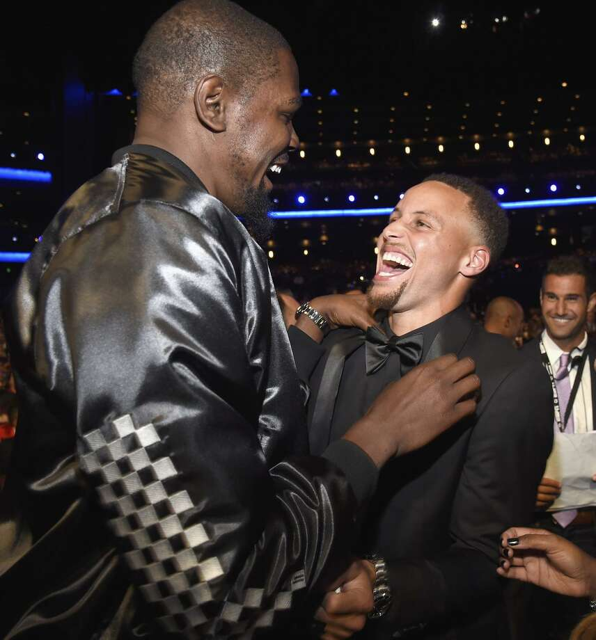 Warriors Kevin Durant (left) and Stephen Curry enjoy themselves at last week's ESPYs. The Warriors were honored as best team, and Durant won for best championship performance. Photo: Kevin Mazur / Getty Images / 2017 Kevin Mazur