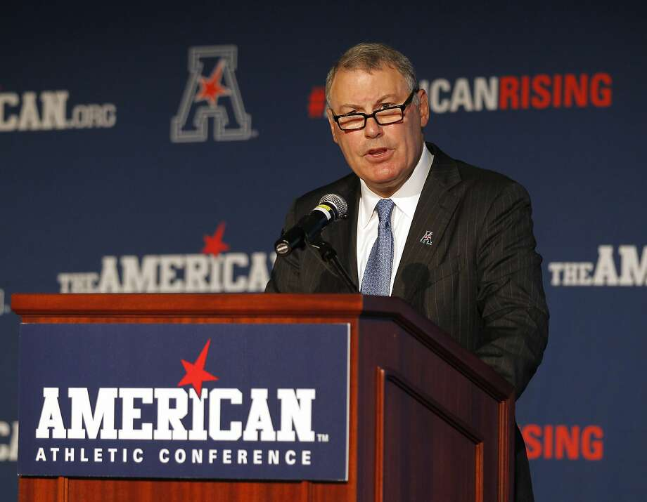 FILE - In this Aug. 4, 2015, file photo, American Athletic Conference Commissioner Mike Aresco addresses the media during an NCAA football media day in Newport, R.I. The AAC gathers for its media day, but hanging over the start of the season is Big 12 expansion. There is a chance the AAC could be lose a member or two (or three or four) when the Big 12 decides to add schools.  (AP Photo/Stew Milne, File) Photo: Stew Milne, Associated Press