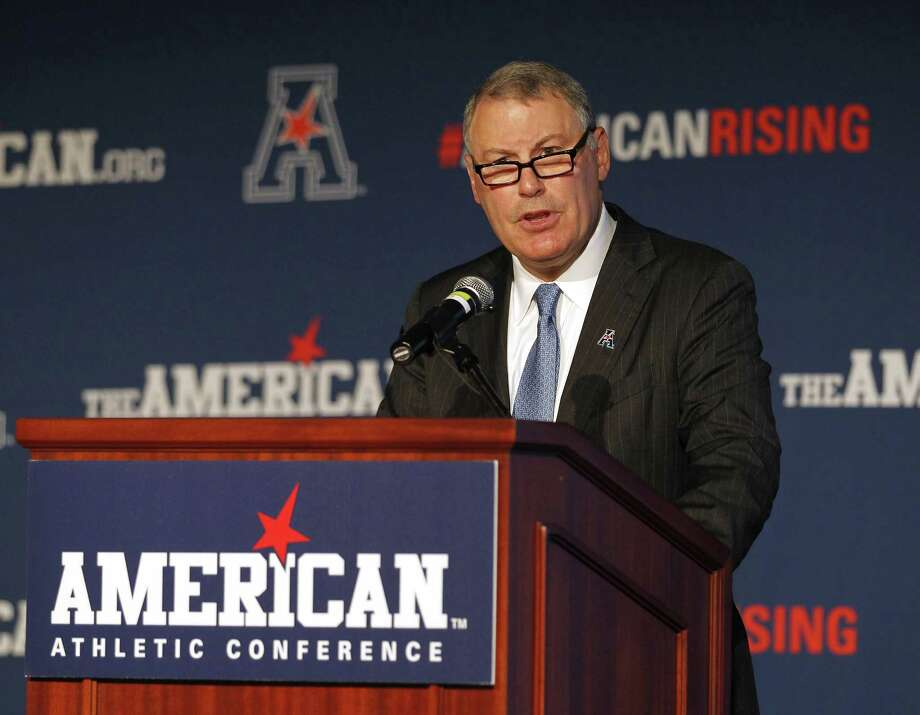 "American Athletic Conference Commissioner Mike Aresco, shown here in an Aug. 4, 2015, file photo, said Tuesday at the league's media day: ""This a critical period for the American Athletic Conference, and we approach it with optimism and confidence."" Photo: Stew Milne / Associated Press / FR56276 AP"