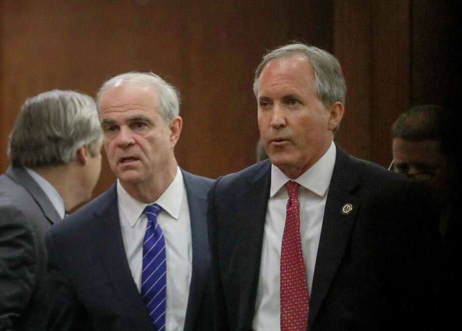 Texas Attorney General Ken Paxton, right, and his attorney Philip Hilder, left, leave the 177th District Court, after at the Harris County Criminal Justice Center, Thursday, June 29, 2017, in Houston. Paxton is facing two counts of felony securities fraud, and a lesser felony charge of failing to register as an insurance adviser with the state. ( Jon Shapley  / Houston Chronicle ) Photo: Jon Shapley, Staff / © 2017 Houston Chronicle
