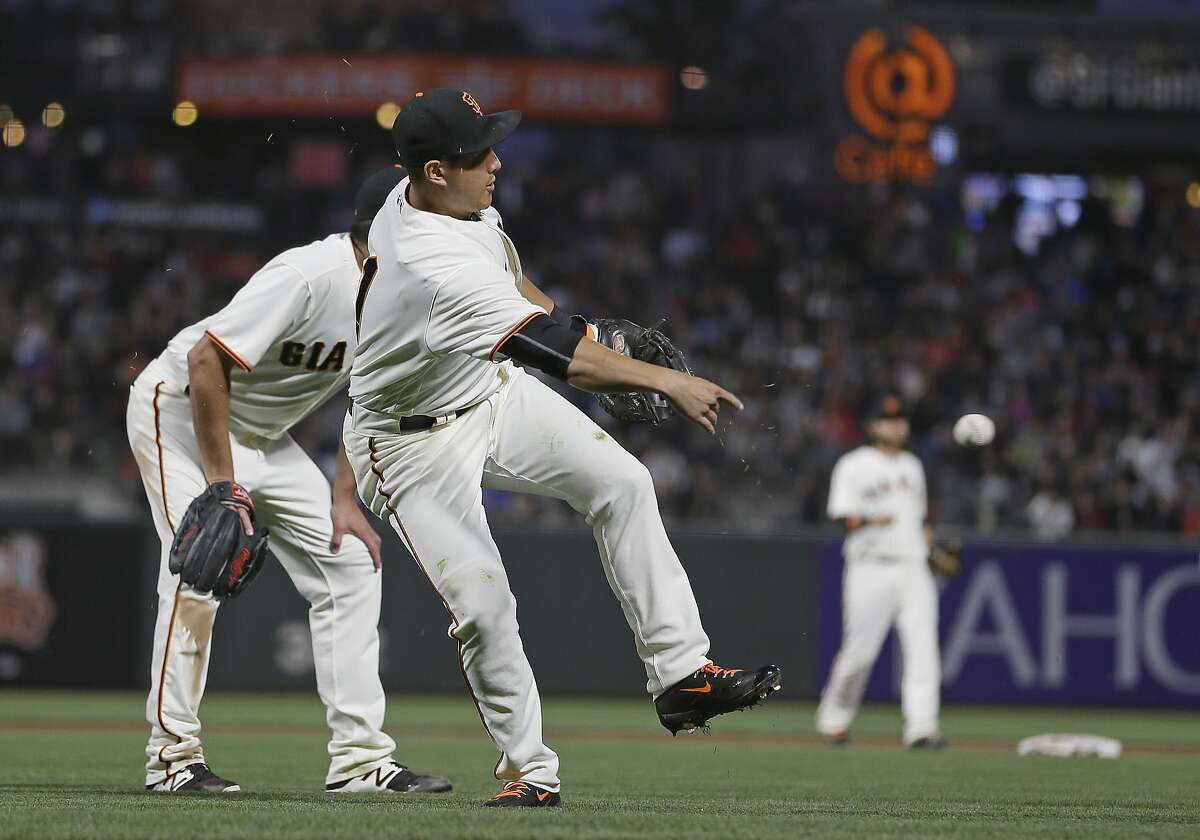 San Francisco Giants first baseman Jae-Gyun Hwang throws the ball to first base after Cleveland Indians' Brandon Guyer laid down a sacrifice bunt during the sixth inning of a baseball game Monday, July 17, 2017, in San Francisco. Hwang was given a throwing error and Jose Ramirez scored on the play. (AP Photo/Eric Risberg)