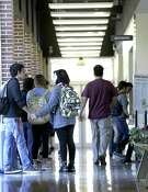 Students line up Wednesday, Nov. 18, 2015 outside the Northwest Vista College's Cypress Campus Center advising area.