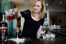Bartender Brooke Arthur at Range restaurant on Valencia St. in San Francisco, Ca., pouring the Bitter Maestro cocktail she just made on Thursday, February 25, 2010.