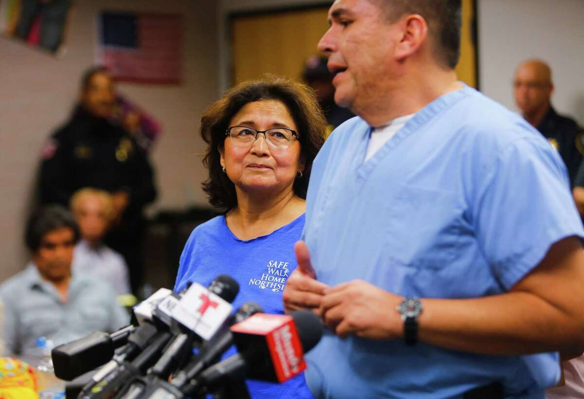 Stella Mireles-Walters (left) listens during an impromptu press conference preceding a planned community meeting of the Safe Walk Home Northside organization, which she founded, at the Carnegie library in Houston's Near Northside neighborhood, Tuesday, July 18, 2017. The group was reacting to the news that the Harris County District Attorney's Office announced Tuesday that they have dropped charges against Andre Jackson, who was being held as a suspect in the May 17, 2016 stabbing death of Josue Flores. Authorities said that DNA evidence proved inconclusive in linking Jackson to the murder.