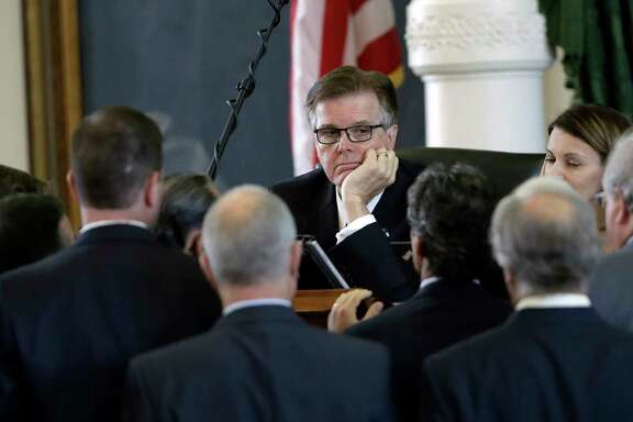 Lt. Gov. Dan Patrick, center, listens to fellow lawmakers during a point of order discussion in the Senate chambers.