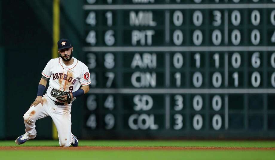Houston Astros shortstop Marwin Gonzalez (9) reacts after Seattle Mariners Jarrod Dyson's ground ball single during the fifth inning of an MLB baseball game at Minute Maid Park, Tuesday, July, 18, 2017. Photo: Karen Warren, Houston Chronicle / 2017 Houston Chronicle
