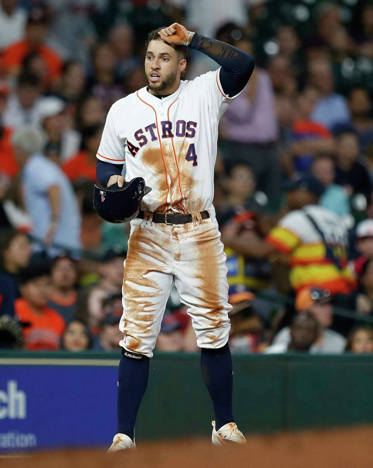 Houston Astros George Springer (4) reacts after he was caught stealing third base during the fourth inning of an MLB baseball game at Minute Maid Park, Tuesday, July, 18, 2017.