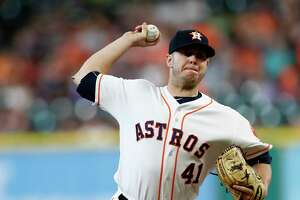 Houston Astros relief pitcher Brad Peacock (41) pitches during the first inning of an MLB baseball game at Minute Maid Park, Tuesday, July, 18, 2017.