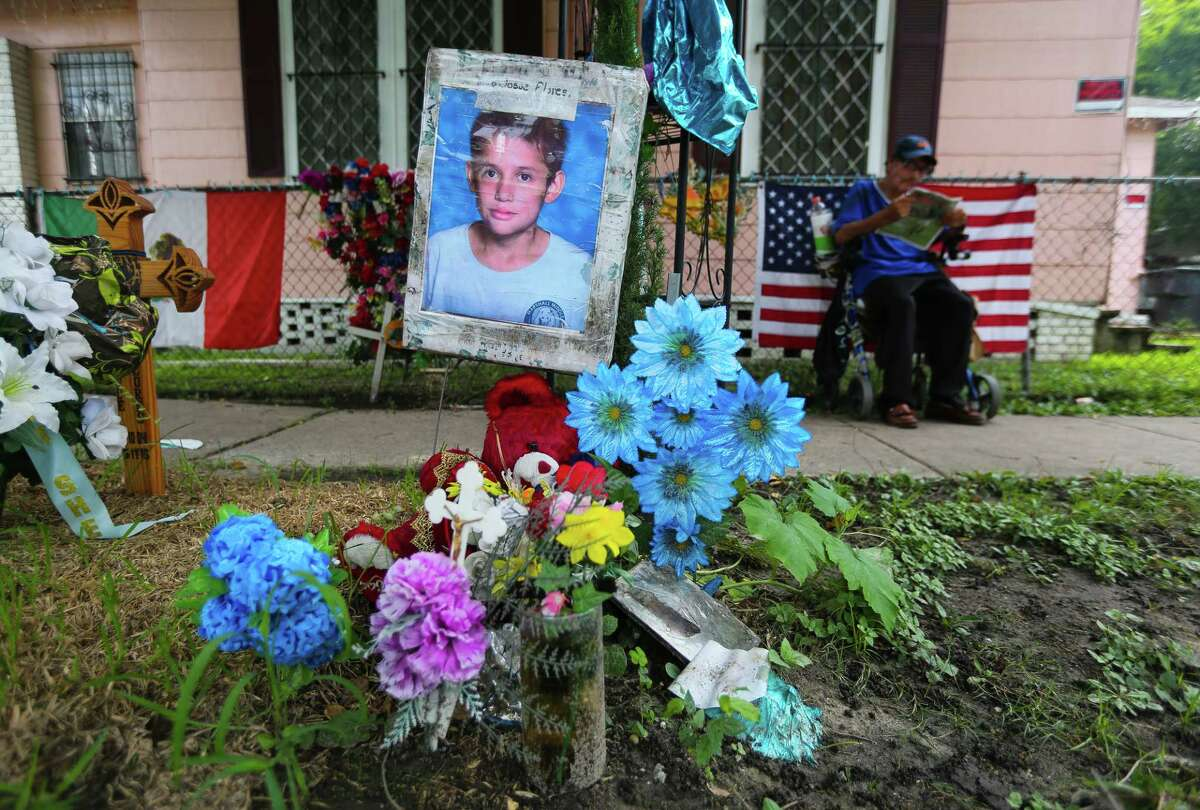 A memorial to 11-year-old Josue Flores rests at the site where he was killed May 17, 2016, in his Near Northside neighborhood.