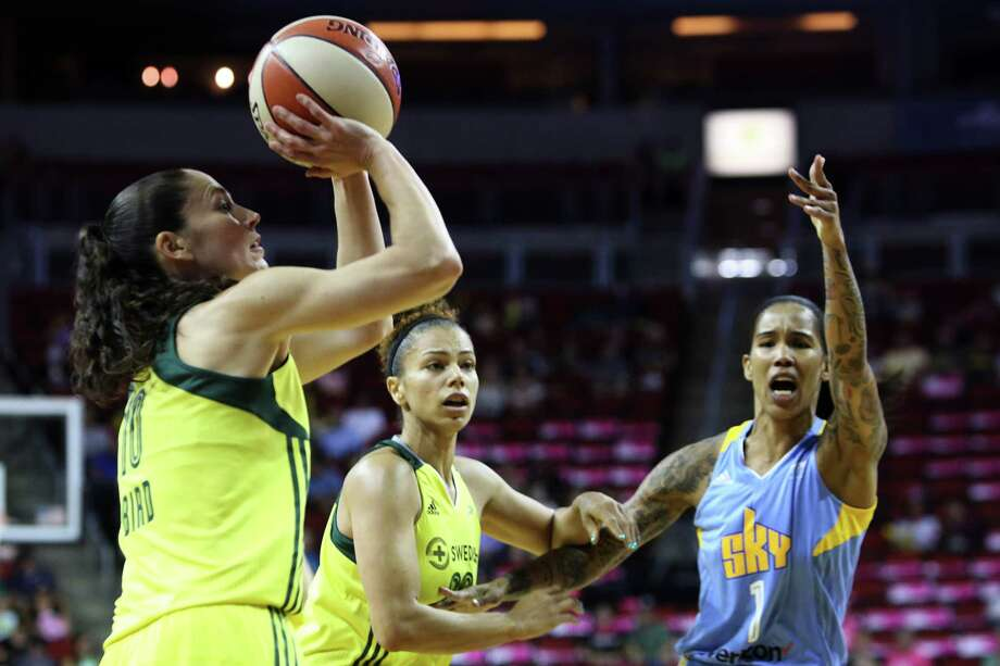 Seattle's Sue Bird, left, shoots during the Storm's game against the Chicago Sky, Tuesday, July 18, 2017 at KeyArena. Photo: GENNA MARTIN, SEATTLEPI.COM / SEATTLEPI.COM