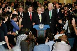 """Sen. Cory Gardner, R-Colo., Sen. John Barrasso, R-Wyo., Senate Majority Leader Mitch McConnell of Ky., Sen. Roy Blunt, R-Mo., and Senate Majority Whip Sen. John Cornyn of Texas, speak on Capitol Hill in Washington, Tuesday, July 18. President Donald Trump blasted congressional Democrats and """"a few Republicans"""" over the collapse of the GOP effort to rewrite the Obama health care law. McConnell proposed a vote on a backup plan simply repealing the statute, but that idea was on the brink of rejection, too. (AP Photo/Carolyn Kaster) ORG XMIT: DCCK117"""