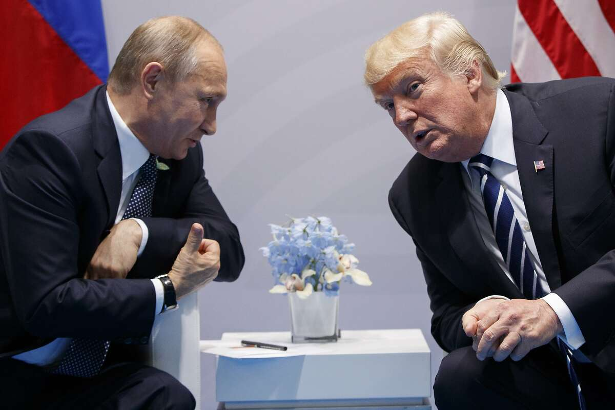 FILE - In this July 7, 2017, file photo, President Donald Trump meets with Russian President Vladimir Putin at the G20 Summit in Hamburg, Germany. Trump had a second, previously undisclosed conversation with Putin at the summit it Germany. White House spokesman Sean Spicer says that Trump and Putin spoke during a world leaders' dinner at the Group of 20 summit in Hamburg earlier this month.(AP Photo/Evan Vucci)