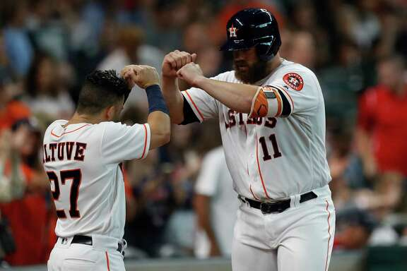 The long and short of it for the Astros' offense Tuesday night were Jose Altuve, left, who had three singles, and Evan Gattis, here receiving congratulations from his diminutive teammate after hitting the first of two homers in the second.