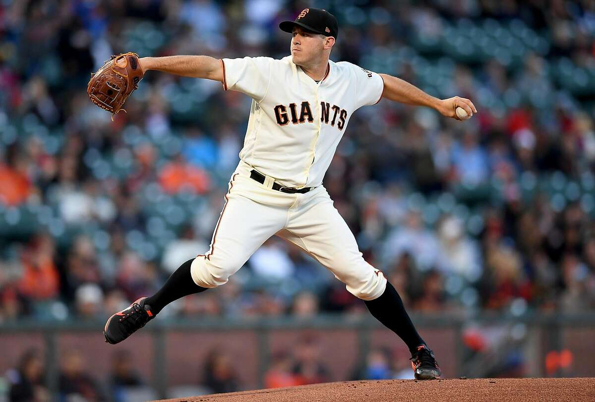 SAN FRANCISCO, CA - JULY 18: Ty Blach #50 of the San Francisco Giants pitches against the Cleveland Indians in the top of the first inning at AT&T Park on July 18, 2017 in San Francisco, California. (Photo by Thearon W. Henderson/Getty Images)