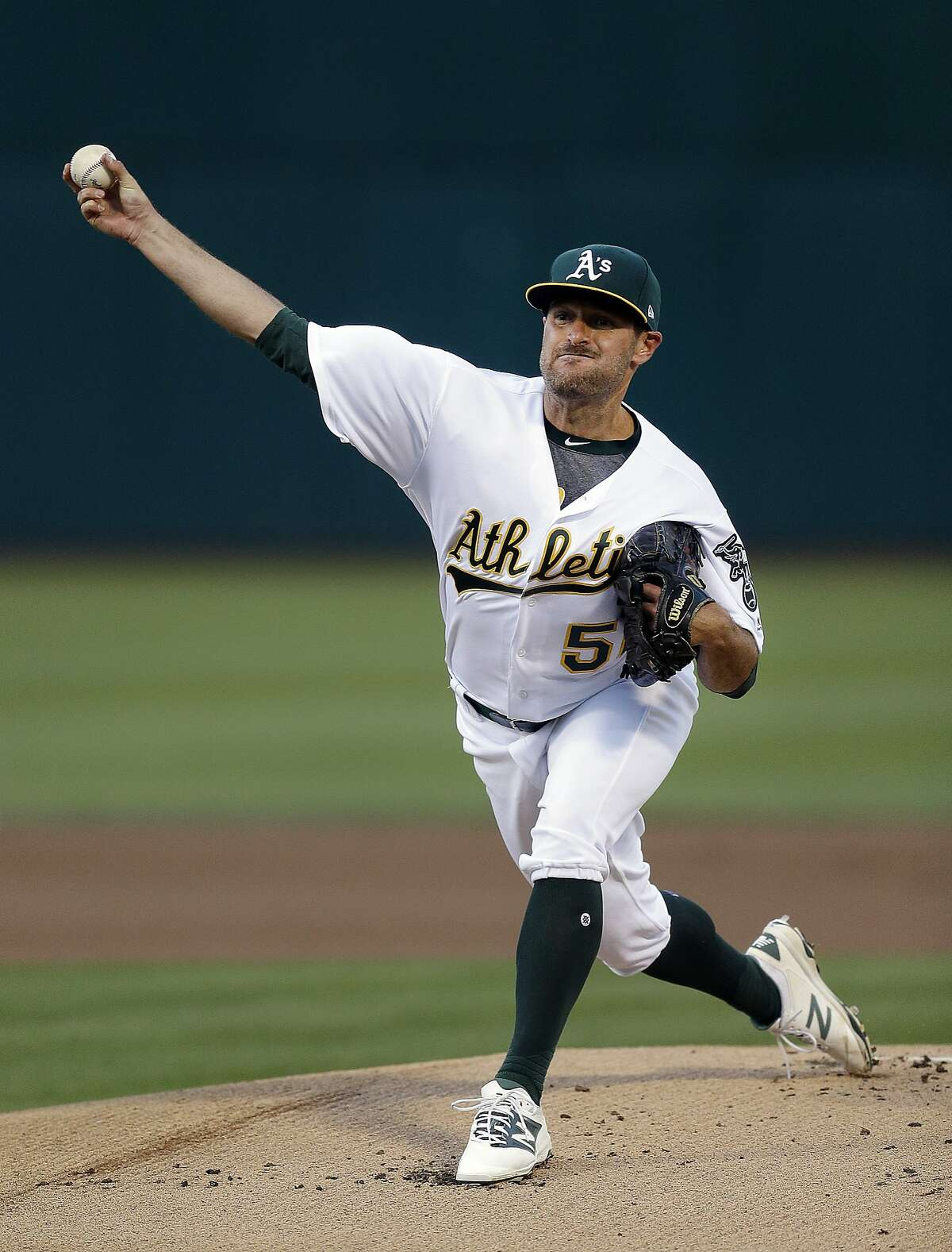 Oakland Athletics pitcher Chris Smith works against the Tampa Bay Rays during the first inning of a baseball game Tuesday, July 18, 2017, in Oakland, Calif. (AP Photo/Ben Margot)