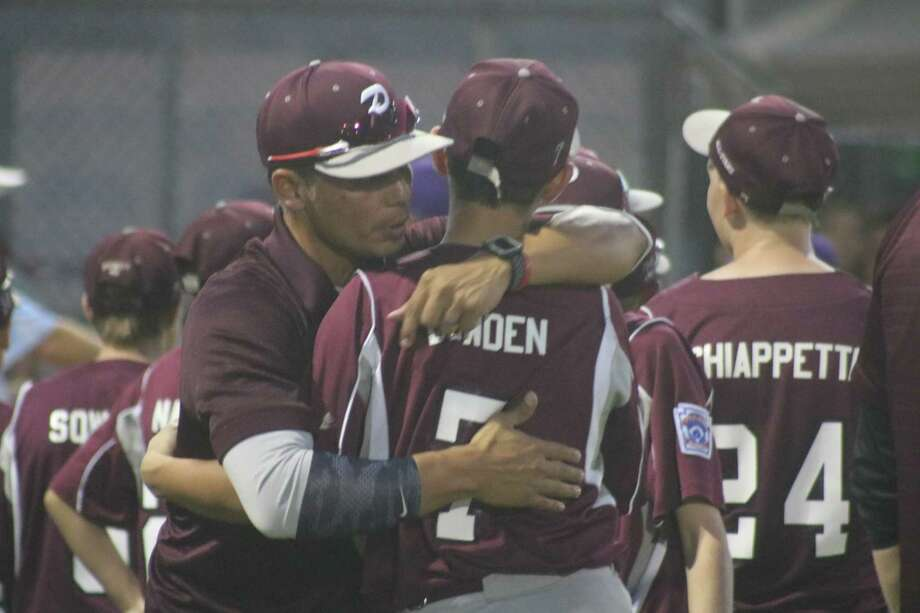 Pearland East manager Gil Avalos went down the line, hugging his players during postgame ceremonies Tuesday night, thanking them for their memorable campaign. Photo: Robert Avery
