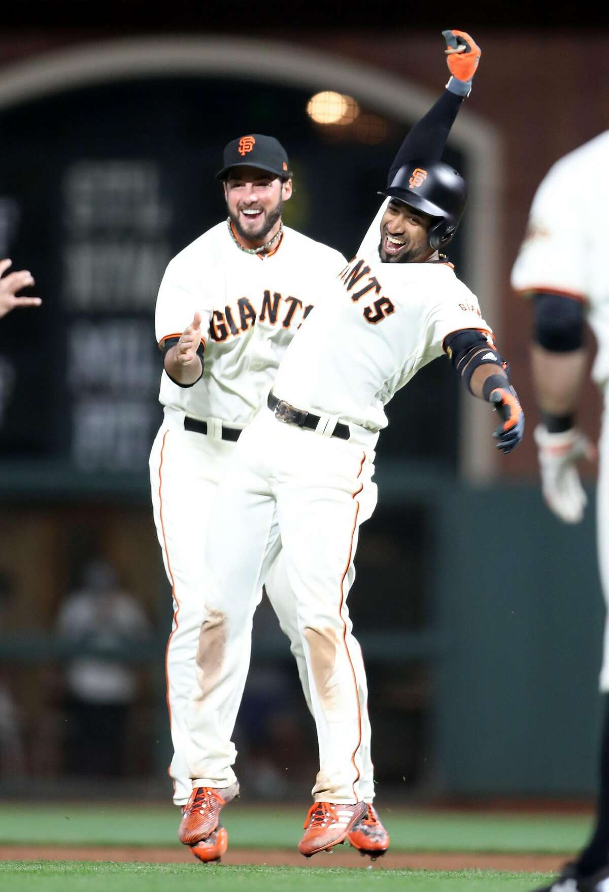 San Francisco Giants' Eduardo Nunez celebrates his game-winning hit with George Kontos in 10th inning of 2-1 win over Cleveland Indians during MLB game at AT&T Park in San Francisco, Calif. on Tuesday, July 18, 2017.