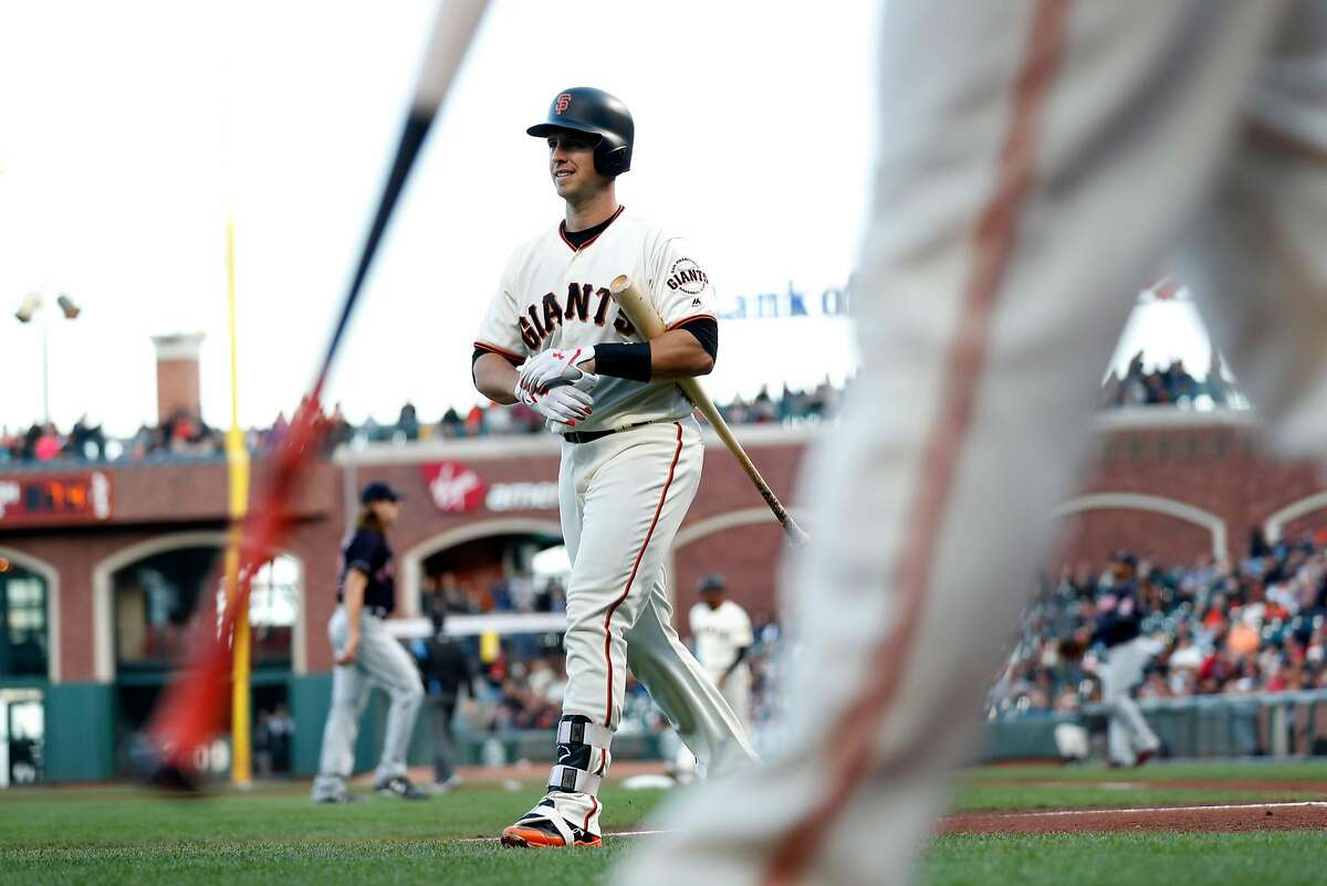 San Francisco Giants' Buster Posey returns to dugout after striking out to end 1st inning against Cleveland Indians during MLB game at AT&T Park in San Francisco, Calif. on Tuesday, July 18, 2017.