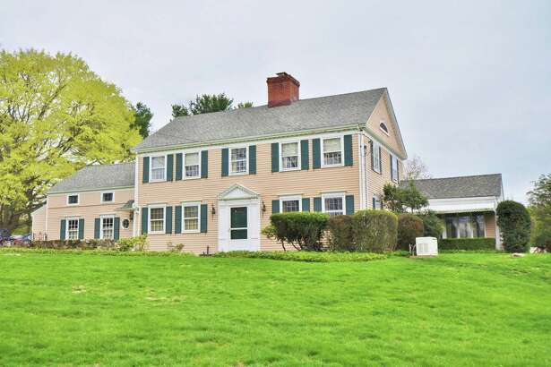 The cream-colored classic colonial house at 15 Mill Hill Lane sits on a 1.5-acre level and attractive property on a cul-de-sac in the Southport section of town.