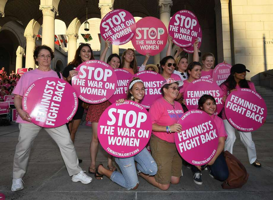 "Supporters and patients of Planned Parenthood take part in a ""Pink the Night Out"" rally at Los Angeles City Hall on June 21. Photo: MARK RALSTON, AFP/Getty Images"