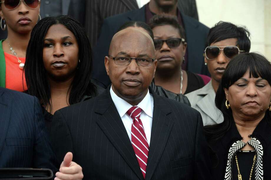 Walter Diggles, center, the Executive Director of the Deep East Texas Council of Governments, his wife Rosie Diggles, right and daughter Anita Diggles, left, are named in a federal indictment stemming from the FBI's 2014 raid of the DETCOG offices. Photo taken during a press conference at the Federal Courthouse on Monday. Photo taken Monday, December 21, 2015 Guiseppe Barranco/The Enterprise Photo: Guiseppe Barranco, Photo Editor